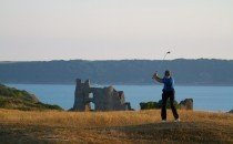 A round of golf overlooking Pennard Castle © City & County of Swansea 2014