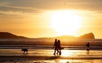 A twilight walk with Worm's Head as a backdrop © City & County of Swansea 2014