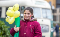 Photo of a girl holding a welsh daffodil at Croeso Swansea