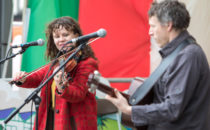 Photo of musicians on stage at Croeso Swansea