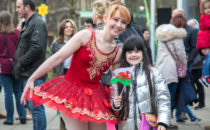 Photo of a dancer with a child from the crowd at Croeso Swansea