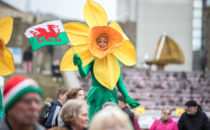 Photo of a performer in a welsh daffodil costume at Croeso Swansea