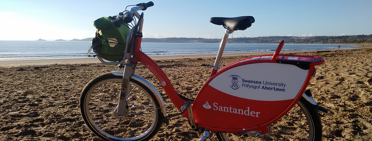 photo of a Santander Cycle on Swansea Bay