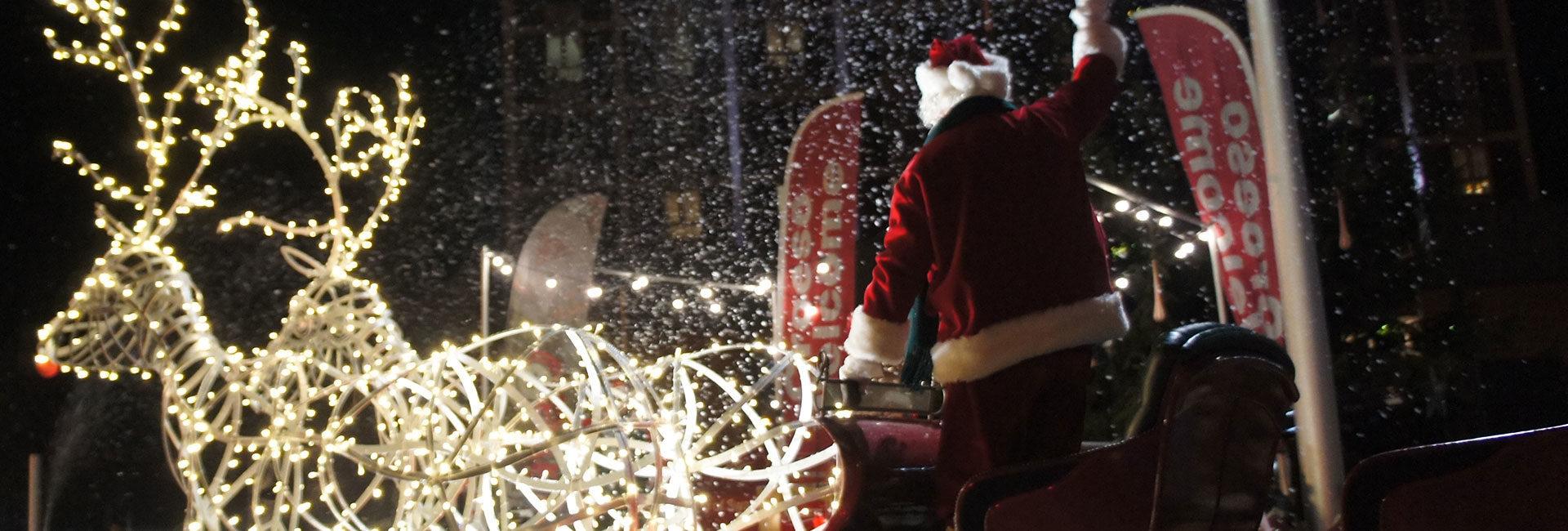 Photo of Santa waving at the Swansea Christmas Parade